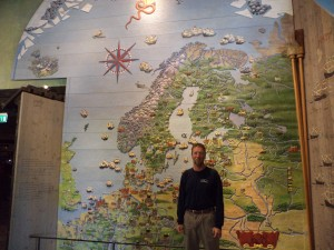 Paul poses in front of a map in Stockholm