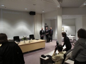 Grand entrance of the candidate, his professor and examiner at a dissertation defense in Finland