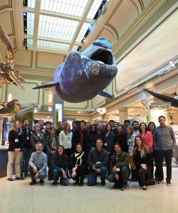 The ZEN conference attendees pose under a blue whale at the Natural History Museum