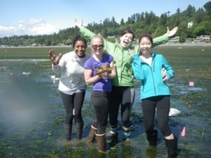 The BC team poses with a Dungeness crab found in the eelgrass bed